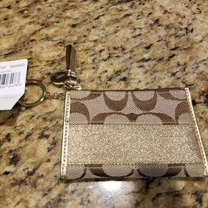 Beige/gold coin purse
